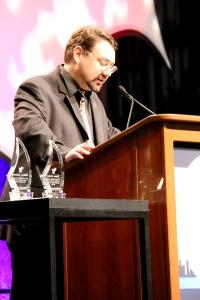 ESP faculty Dr. Chris Parsons introducing a plenary speaker